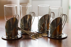 Four cups Stock Images