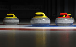 Four curling stones. Group of four curling stones in the rings with a black background and reflective ice Stock Photography