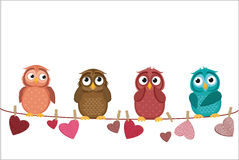 Four cute colored owlet sitting on a string. A red hearts Stock Photography