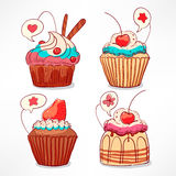 Four cute cupcakes. Set with four cute cupcakes with cream and berries Stock Images