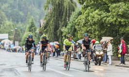 Four Cyclists Riding in the Rain Royalty Free Stock Image