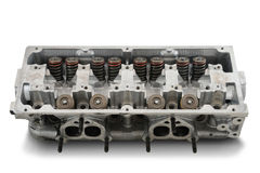 Four cylinder engine head. On white Stock Image