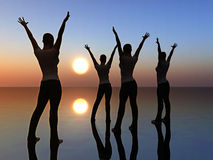 Four dancing women. Digital composition of four women looking at the sunrise dancing full of joy. symbol of success and peace Stock Images