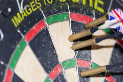 Four darts in dartboard Royalty Free Stock Photos