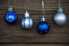 Four Decorated Christmas Balls on Wood Stock Image