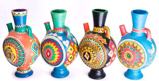Four decorated colorful handcrafted pottery jugs Stock Photo