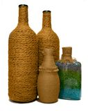 Four decorative bottles hand made. Isolated by white background Stock Image