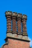 Four decorative chimneys Stock Images