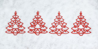 Four decorative Christmas tree closeup. Stock Photos