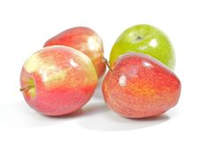 Four delicious apples on white background Royalty Free Stock Photography