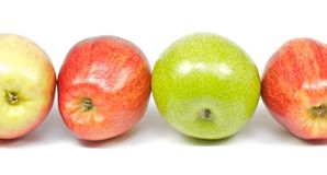 Four delicious apples on white background Stock Photo