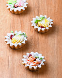 Four delicious cream basket Royalty Free Stock Photography