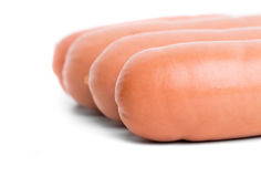 Four delicious sausages. Stock Photo