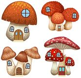Four designs of mushroom houses Royalty Free Stock Images