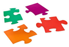 Four detached jigsaw puzzle pieces Stock Photography