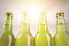 Four dewy bottles with fresh beer Stock Images