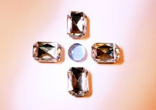 Four diamonds and a pearl Stock Images