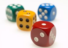 Four dice. Four colored dice Stock Image