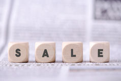 Four dice with sale word written on Stock Photos