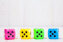 Four  dice on the wooden background Stock Photo