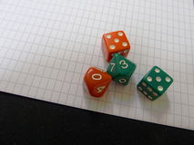 Four dices. On a paper Stock Image