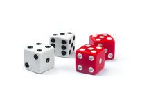 Four dices. Two white dices score seven and two red dice score ten Stock Photos