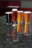 Four different beers Stock Image