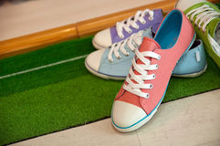 Four different color shoes. On the floor,which taken on May 17th.2010 royalty free stock image