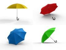 Four different color umbrellas Stock Photo