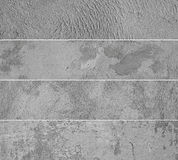 Four different concrete wall background close-up, asphalt texture. Royalty Free Stock Images