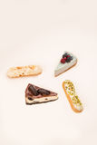 Four different desserts isolated over white Royalty Free Stock Photography