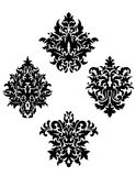 Four different foliate arabesque motifs Royalty Free Stock Photography