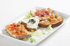 Four different kind of bruschetta Stock Images