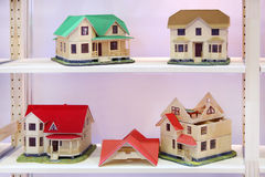 Four different models of cottages Royalty Free Stock Photos
