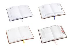 Four different open multi language business diary Royalty Free Stock Photo