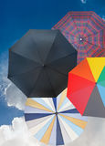 Four different open umbrellas with dark blue sky Stock Photography
