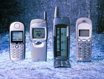 Four different phones Stock Photography