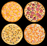 Four different pizzas, isolated Stock Photography