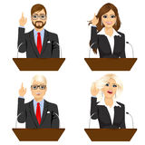 Four different politicians speaking on microphone Stock Photo
