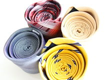 Four different rolled color luxury ties Royalty Free Stock Photography