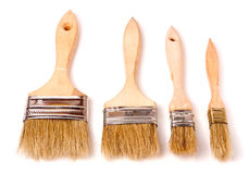 Four different size paint brushes isolated on white background Royalty Free Stock Images