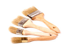 Four different size paint brushes isolated on white background Stock Image