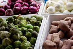 Four vegetables in bins at street market stock photo