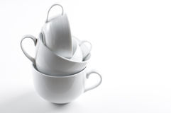 Four different white cups Stock Images