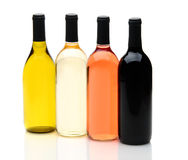 Four Different Wine Bottles on White. Four wine bottles on a white background with reflections, one each of chardonnay, white zinfandel, cabernet sauvignon, and Royalty Free Stock Photography