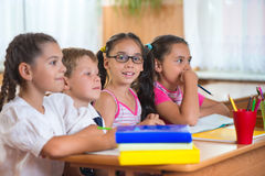 Four diligent pupils studying at classroom Royalty Free Stock Photos