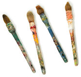 Four dirty brushes. Stock Photography