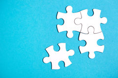 Four disconnected jigsaw puzzle pieces Royalty Free Stock Photos