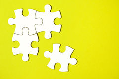 Four disconnected jigsaw puzzle pieces Royalty Free Stock Photo