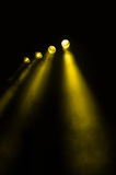 Four diverging spots with yellow beams Royalty Free Stock Photo